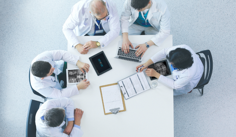group of doctors at a table viewed from above