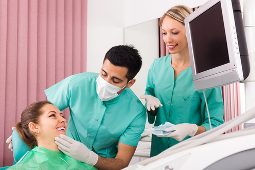 dentists examining patient jaw occlusion tmj