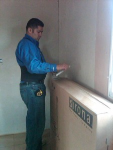 A man opening a large box.