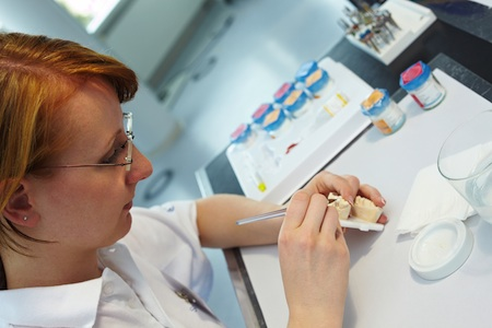 technician working in dental lab Web